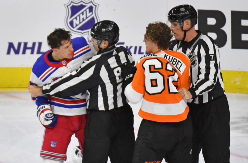 Mar 25, 2021; Philadelphia, Pennsylvania, USA; New York Rangers center Ryan Strome (16) and Philadelphia Flyers right wing Nicolas Aube-Kubel (62) are separated by linesman Tony Sericolo (84) and linesman Brad Kovachik (71) during the third period at Wells Fargo Center. Mandatory Credit: Eric Hartline-USA TODAY Sports