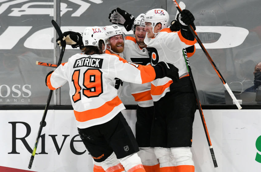 Apr 5, 2021; Boston, Massachusetts, USA; Philadelphia Flyers defenseman Travis Sanheim (6) celebrates with his teammates after scoring against the Boston Bruins during an overtime period at the TD Garden. Mandatory Credit: Brian Fluharty-USA TODAY Sports