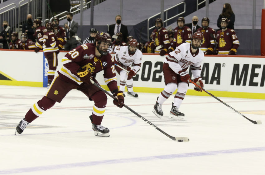 Apr 8, 2021; Pittsburgh, PA, USA; Minnesota Duluth Bulldogs forward Jackson Cates (20) moves the puck down the ice against the UMass Minutemen during the first period in the semifinals of the 2021 Frozen Four NCAA hockey tournament at PPG Paints Arena. Mandatory Credit: Charles LeClaire-USA TODAY Sports