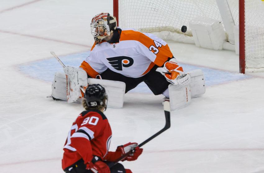 Apr 29, 2021; Newark, New Jersey, USA; New Jersey Devils center Jesper Boqvist (90) scores a goal past Philadelphia Flyers goaltender Alex Lyon (34) during the second period at Prudential Center. Mandatory Credit: Vincent Carchietta-USA TODAY Sports