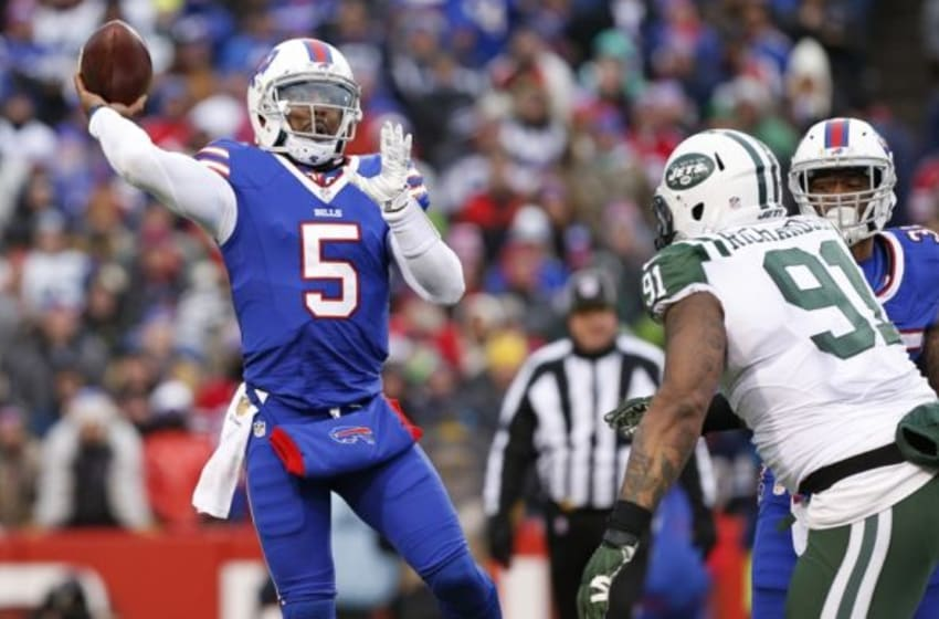 Jan 3, 2016; Orchard Park, NY, USA; Buffalo Bills quarterback Tyrod Taylor (5) throws a pass under pressure by New York Jets defensive end Sheldon Richardson (91) during the second half at Ralph Wilson Stadium. Bills beat the Jets 22-17. Mandatory Credit: Kevin Hoffman-USA TODAY Sports