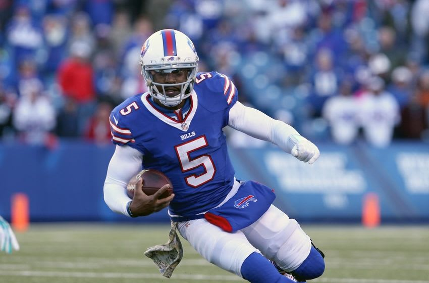 Nov 8, 2015; Orchard Park, NY, USA; Buffalo Bills quarterback Tyrod Taylor (5) runs the ball during the second half against the Miami Dolphins at Ralph Wilson Stadium. Buffalo beats Miami 33 to 17. Mandatory Credit: Timothy T. Ludwig-USA TODAY Sports