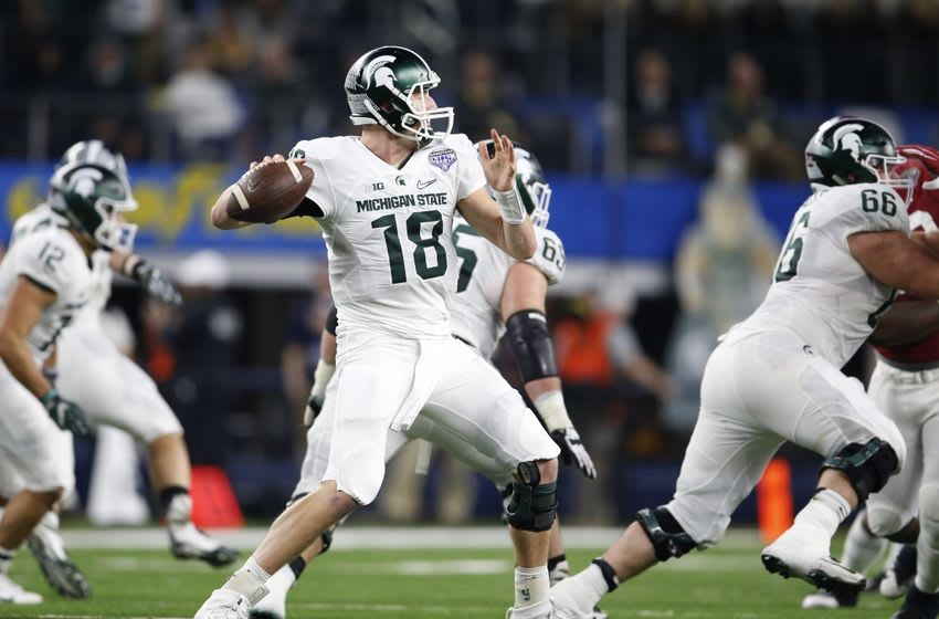 Dec 31, 2015; Arlington, TX, USA; Michigan State Spartans quarterback Connor Cook (18) in action against Alabama Crimson Tide in the second half of the 2015 CFP semifinal at the Cotton Bowl at AT&T Stadium. Mandatory Credit: Matthew Emmons-USA TODAY Sports