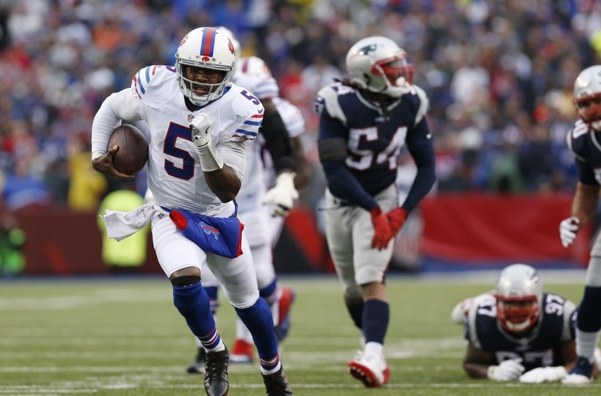Oct 30, 2016; Orchard Park, NY, USA; Buffalo Bills quarterback Tyrod Taylor (5) runs with the ball for a touchdown during the second half against the New England Patriots at New Era Field. The Patriots beat the Bills 41-25. Mandatory Credit: Kevin Hoffman-USA TODAY Sports
