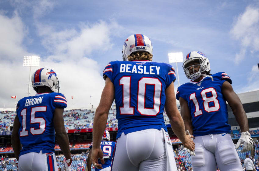 ORCHARD PARK, NY - SEPTEMBER 29: Andre Roberts #18 of the Buffalo Bills warms up with Cole Beasley #10 before the game against the New England Patriots at New Era Field on September 29, 2019 in Orchard Park, New York. New England defeats Buffalo 16-10. (Photo by Brett Carlsen/Getty Images)