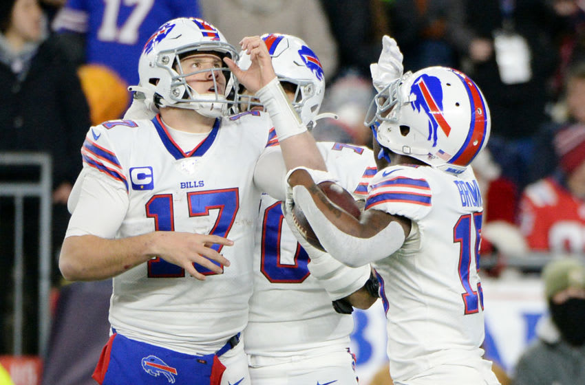 FOXBOROUGH, MASSACHUSETTS - DECEMBER 21: John Brown #15 of the Buffalo Bills celebrates with Josh Allen #17 after scoring a touchdown during the third quarter against the New England Patriots in the game at Gillette Stadium on December 21, 2019 in Foxborough, Massachusetts. (Photo by Kathryn Riley/Getty Images)