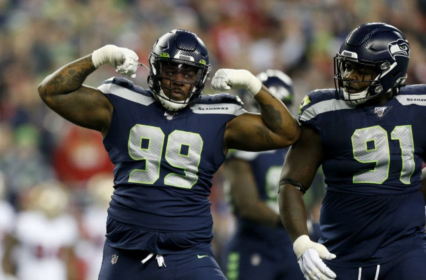 SEATTLE, WASHINGTON - DECEMBER 29: Defensive tackle Quinton Jefferson #99 of the Seattle Seahawks celebrates sacking quarterback Jimmy Garoppolo #10 (not pictured) of the San Francisco 49ers during the first quarter of the game at CenturyLink Field on December 29, 2019 in Seattle, Washington. (Photo by Otto Greule Jr/Getty Images)