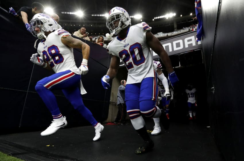HOUSTON, TEXAS - JANUARY 04: Running back Frank Gore #20 and \ Kurt Coleman #28 of the Buffalo Bills run out of the tunnel before the AFC Wild Card Playoff game against the Houston Texans at NRG Stadium on January 04, 2020 in Houston, Texas. (Photo by Tim Warner/Getty Images)