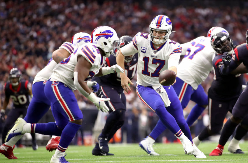 HOUSTON, TEXAS - JANUARY 04: Josh Allen #17 hands the ball off to Devin Singletary #26 of the Buffalo Bills against the Houston Texans during the first quarter of the AFC Wild Card Playoff game at NRG Stadium on January 04, 2020 in Houston, Texas. (Photo by Christian Petersen/Getty Images)