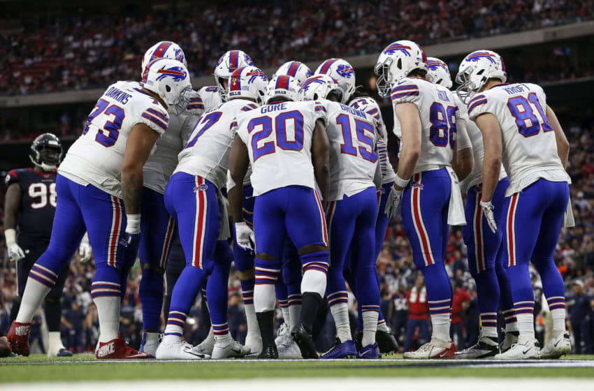 HOUSTON, TEXAS - JANUARY 04: The Buffalo Bills huddle in the first half of the AFC Wild Card Playoff game against the Houston Texans at NRG Stadium on January 04, 2020 in Houston, Texas. (Photo by Tim Warner/Getty Images)