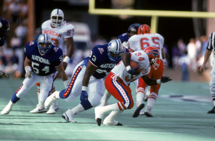 HONOLULU, HI - FEBRUARY 4: Detroit Lions defensive tackle Jerry Ball #93 of the NFC goes after Buffalo Bills running back Thurman Thomas #34 of the AFC during the 1990 NFL Pro Bowl at Aloha Stadium on February 4, 1990 in Honolulu, Hawaii. The NFC won 27-21. (Photo by George Rose/Getty Images)