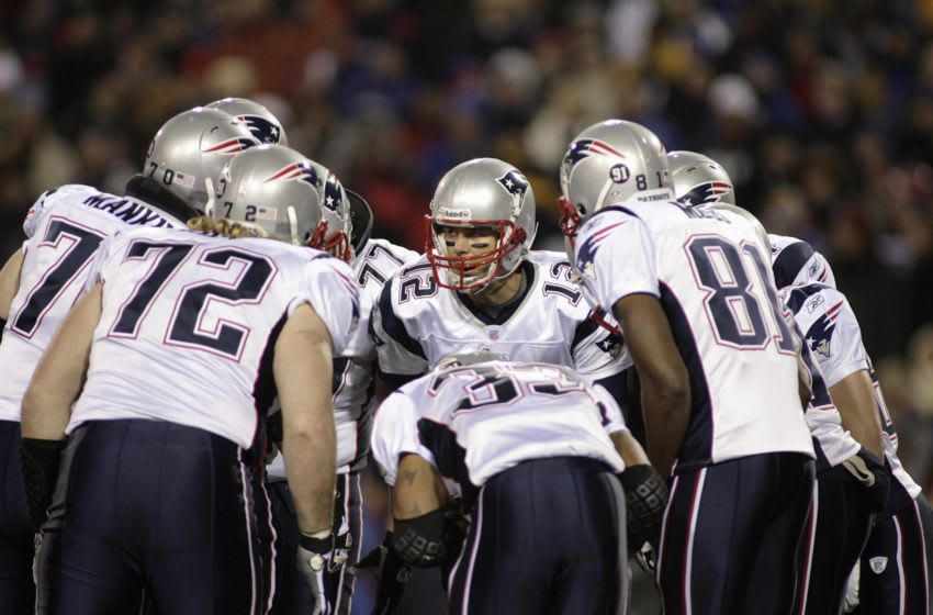 BUFFALO, NY - NOVEMBER 18: Tom Brady #12 of the New England Patriots leads the huddle during the game against the Buffalo Bills at Ralph Wilson Stadium November 18, 2007 in Orchard Park, New York. (Photo by Rick Stewart/Getty Images)