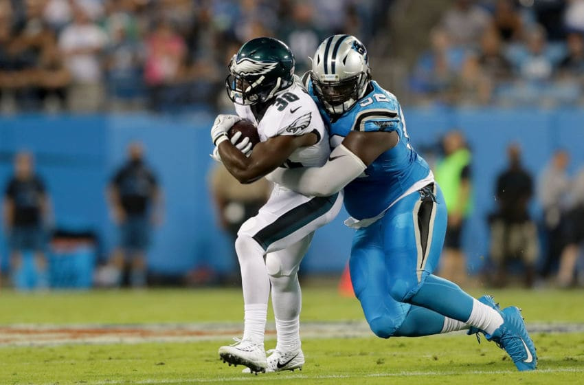 CHARLOTTE, NC - OCTOBER 12: Vernon Butler #92 of the Carolina Panthers tackles Kenjon Barner #38 of the Philadelphia Eagles in the first quarter during their game at Bank of America Stadium on October 12, 2017 in Charlotte, North Carolina. (Photo by Streeter Lecka/Getty Images)