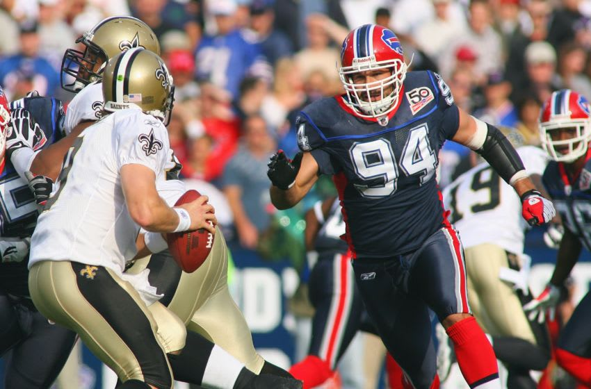 ORCHARD PARK, NY - SEPTEMBER 27: Aaron Schobel #94 of the Buffalo Bills rushes quarterback Drew Brees #9 of the New Orleans Saints at Ralph Wilson Stadium on September 27, 2009 in Orchard Park, New York. (Photo by Rick Stewart/Getty Images)
