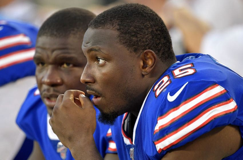 CHARLOTTE, NORTH CAROLINA - AUGUST 16: Frank Gore #20 talks with LeSean McCoy #25 of the Buffalo Bills during the second quarter of their preseason game against the Carolina Panthers at Bank of America Stadium on August 16, 2019 in Charlotte, North Carolina. (Photo by Grant Halverson/Getty Images)
