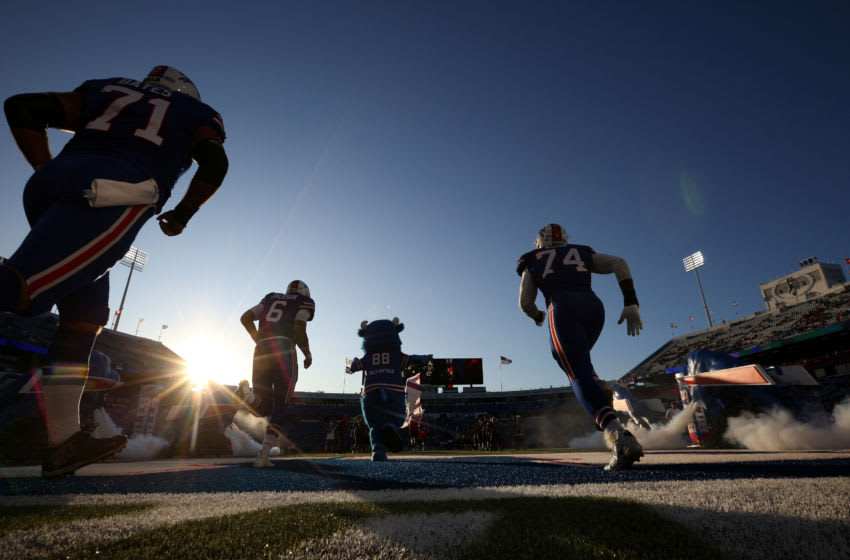 ORCHARD PARK, NEW YORK - AUGUST 29: Buffalo Bills players run onto the field before a preseason game against the Minnesota Vikings at New Era Field on August 29, 2019 in Orchard Park, New York. (Photo by Bryan M. Bennett/Getty Images)