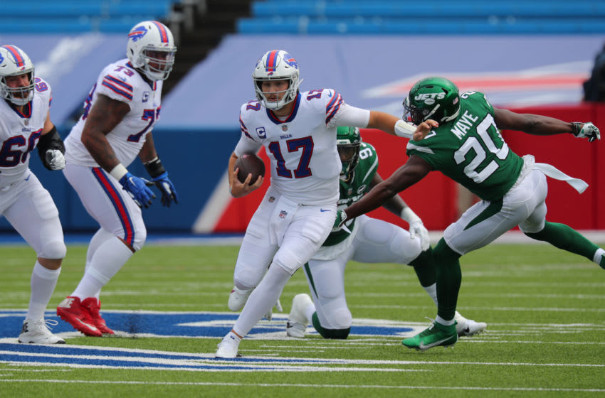 ORCHARD PARK, NY - SEPTEMBER 13: Marcus Maye #20 of the New York Jets tries to make a tackle as Josh Allen #17 of the Buffalo Bills runs the ball during the first quarter at Bills Stadium on September 13, 2020 in Orchard Park, New York. (Photo by Timothy T Ludwig/Getty Images)