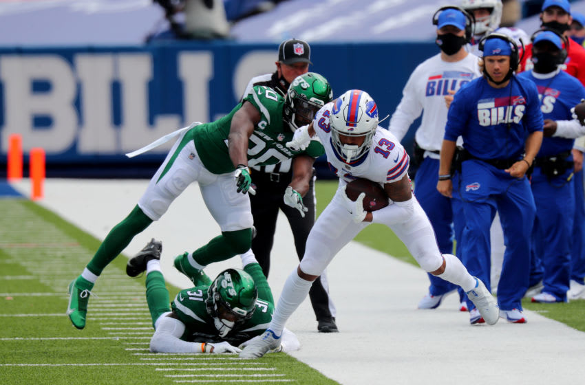 ORCHARD PARK, NY - SEPTEMBER 13: Blessuan Austin #31 of the New York Jets and Marcus Maye #20 push Gabriel Davis #13 of the Buffalo Bills out of bounds after he makes a catch during the first quarter at Bills Stadium on September 13, 2020 in Orchard Park, New York. (Photo by Timothy T Ludwig/Getty Images)