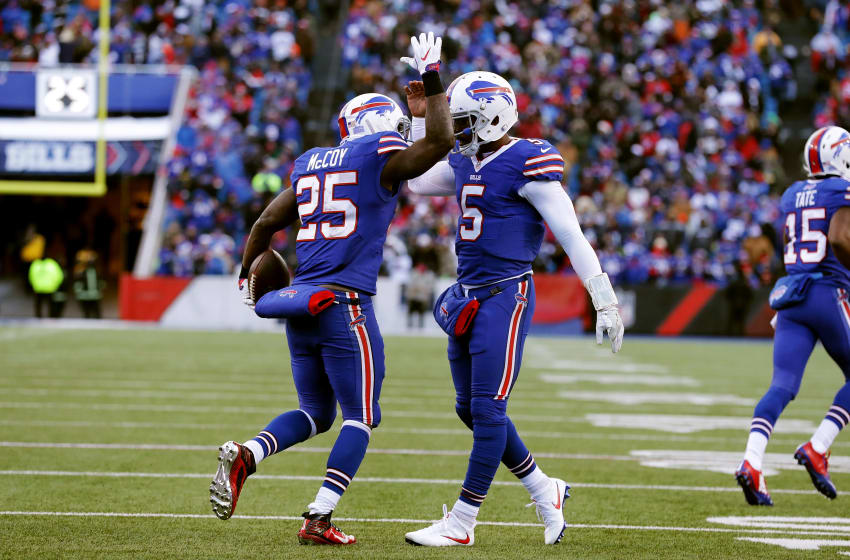 ORCHARD PARK, NY - DECEMBER 18: Tyrod Taylor #5 of the Buffalo Bills congratulates LeSean McCoy #25 of the Buffalo Bills after a touchdown against the Cleveland Browns during the second half at New Era Field on December 18, 2016 in Orchard Park, New York. (Photo by Brett Carlsen/Getty Images)