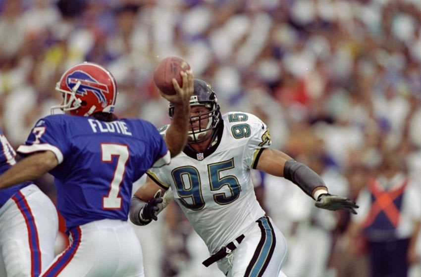 18 Oct 1998: Linebacker Bruce Paup #95 of the Jacksonville Jaguars in action against quarterback Doug Flutie #7 of the Buffalo Bills during the game at the Rich Stadium in Orchard Park, New York. The Bills defeated the Jaguars 17-16.