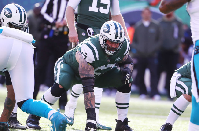 EAST RUTHERFORD, NJ - NOVEMBER 26: Brian Winters #67 of the New York Jets in action against the Carolina Panthers during their game at MetLife Stadium on November 26, 2017 in East Rutherford, New Jersey. (Photo by Al Bello/Getty Images)