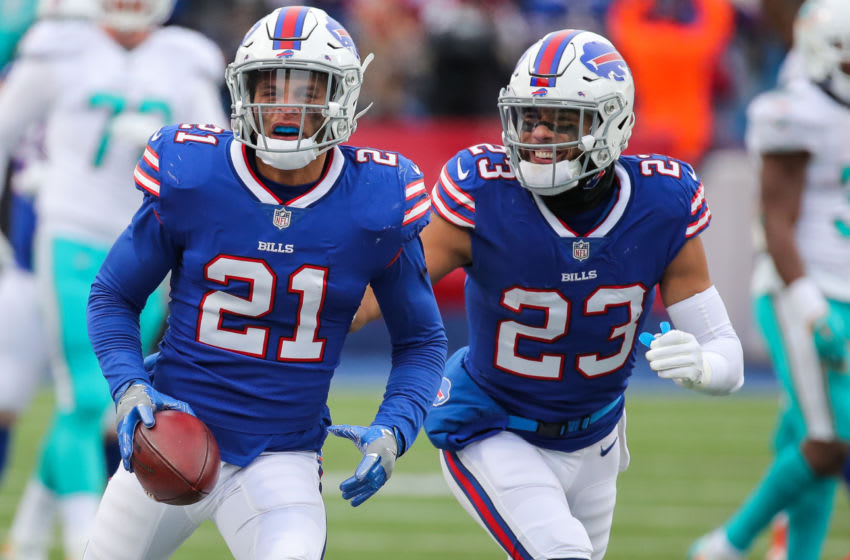 ORCHARD PARK, NY - DECEMBER 17: Jordan Poyer #21 of the Buffalo Bills celebrates with teammate Micah Hyde #23 after intercepting the ball during the third quarter against Miami Dolphins on December 17, 2017 at New Era Field in Orchard Park, New York. (Photo by Brett Carlsen/Getty Images)
