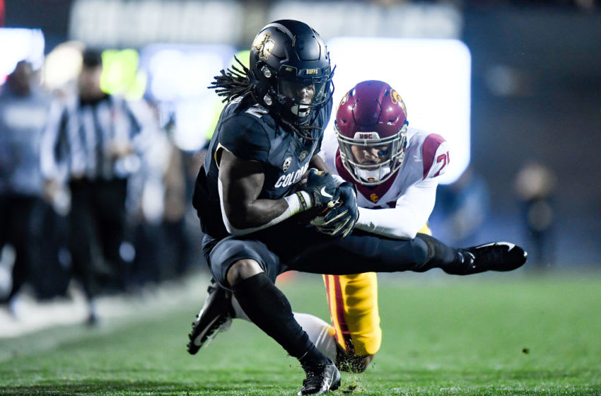 BOULDER, CO - OCTOBER 25: Laviska Shenault Jr. #2 of the Colorado Buffaloes is tackled after a catch by Isaiah Pola-Mao #21 of the USC Trojans in the second quarter of a game at Folsom Field on October 25, 2019 in Boulder, Colorado. (Photo by Dustin Bradford/Getty Images)
