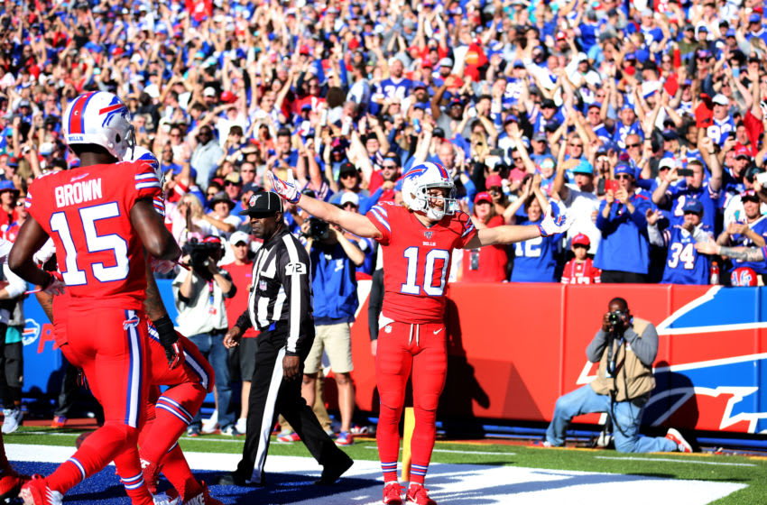 ORCHARD PARK, NEW YORK - OCTOBER 20: Cole Beasley #10 of the Buffalo Bills celebrates after scoring a touchdown during the fourth quarter of an NFL game against the Miami Dolphins at New Era Field on October 20, 2019 in Orchard Park, New York. (Photo by Bryan M. Bennett/Getty Images)