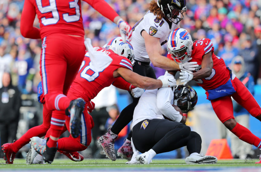 ORCHARD PARK, NEW YORK - DECEMBER 08: Matt Milano #58 and Levi Wallace #39 of the Buffalo Bills tackle Lamar Jackson #8 of the Baltimore Ravens during the first half in the game at New Era Field on December 08, 2019 in Orchard Park, New York. (Photo by Brett Carlsen/Getty Images)