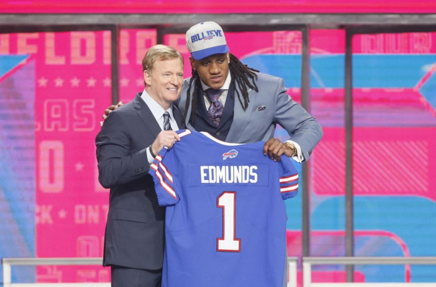 Apr 26, 2018; Arlington, TX, USA; Tremaine Edmunds (Virginia Tech) with NFL commissioner Roger Goodell after being selected as the number sixteen overall pick to the Buffalo Bills in the first round of the 2018 NFL Draft at AT&T Stadium. Mandatory Credit: Tim Heitman-USA TODAY Sports