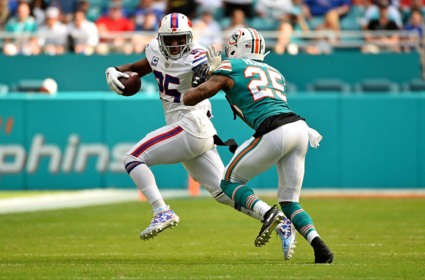 Dec 2, 2018; Miami Gardens, FL, USA; Buffalo Bills running back LeSean McCoy (25) carries the ball around Miami Dolphins cornerback Xavien Howard (25) during the first half at Hard Rock Stadium. Mandatory Credit: Jasen Vinlove-USA TODAY Sports