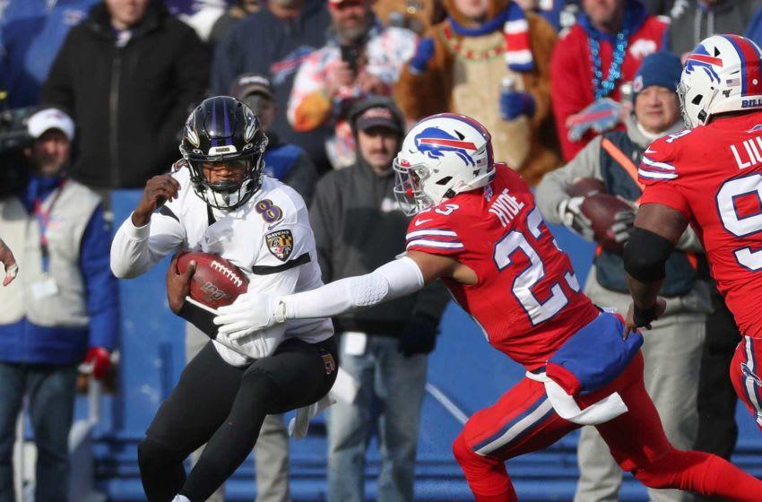 Ravens quarterback Lamar Jackson tries to slip a tackle by Bills defender Micah Hyde. Jg 120819 Bills 45