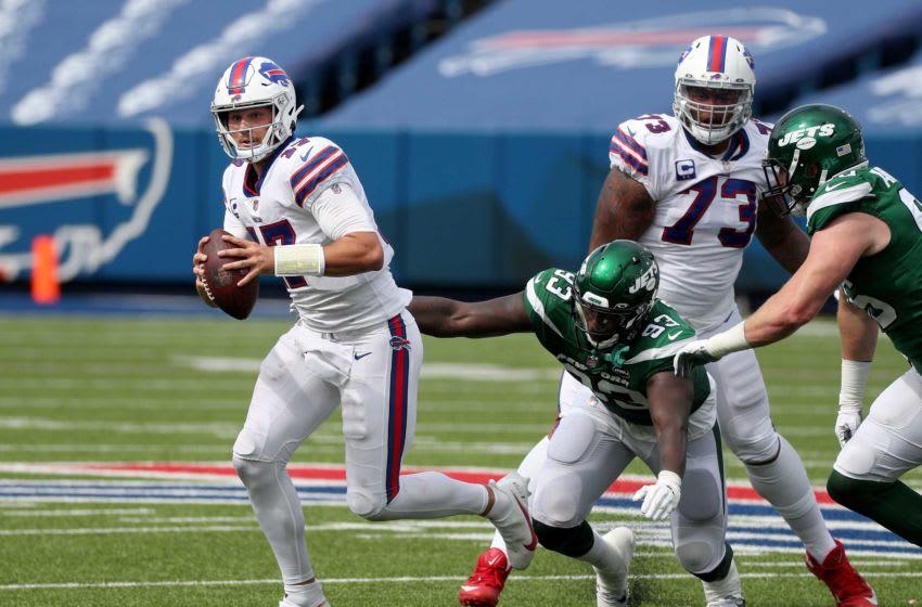 Jets Tarell Bashem can't reach Bills quarterback Josh Allen who rolls out of pressure. Jg 091320 Bills 24