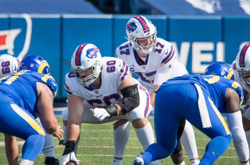Sep 27, 2020; Orchard Park, New York, USA; Buffalo Bills quarterback Josh Allen (17) at the line of scrimmage with center Mitch Morse (60) in the second quarter of a game against the Los Angeles Rams at Bills Stadium. Mandatory Credit: Mark Konezny-USA TODAY Sports