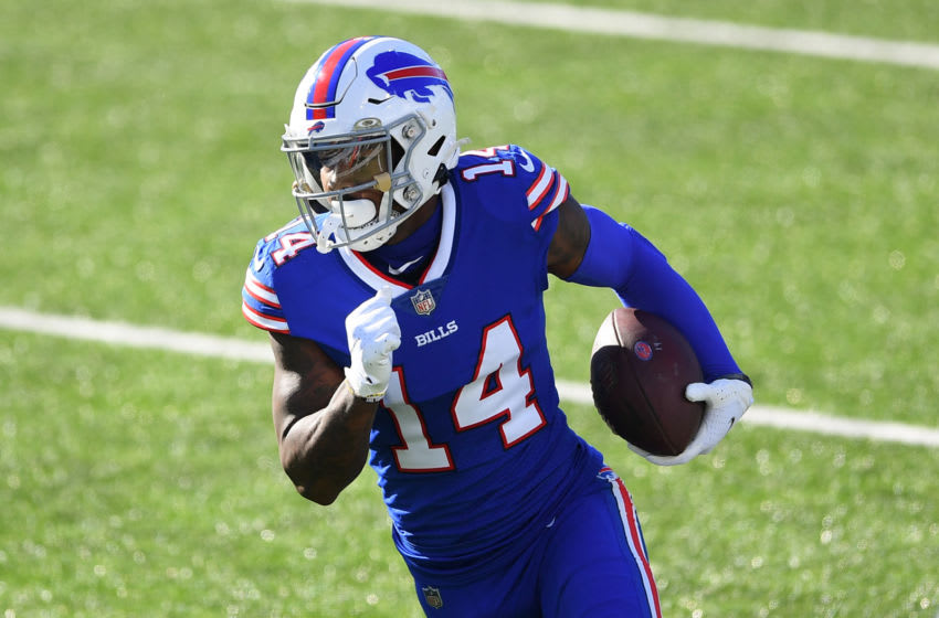 Nov 8, 2020; Orchard Park, New York, USA; Buffalo Bills wide receiver Stefon Diggs (14) runs with the ball after a catch against the Seattle Seahawks during the first quarter at Bills Stadium. Mandatory Credit: Rich Barnes-USA TODAY Sports