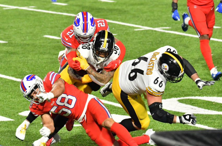 Dec 13, 2020; Orchard Park, New York, USA; Pittsburgh Steelers running back Jaylen Samuels (38) is tackled by Buffalo Bills free safety Jordan Poyer (21) and outside linebacker Matt Milano (58) as offensive guard David DeCastro (66) blocks in the second quarter at Bills Stadium. Mandatory Credit: Mark Konezny-USA TODAY Sports