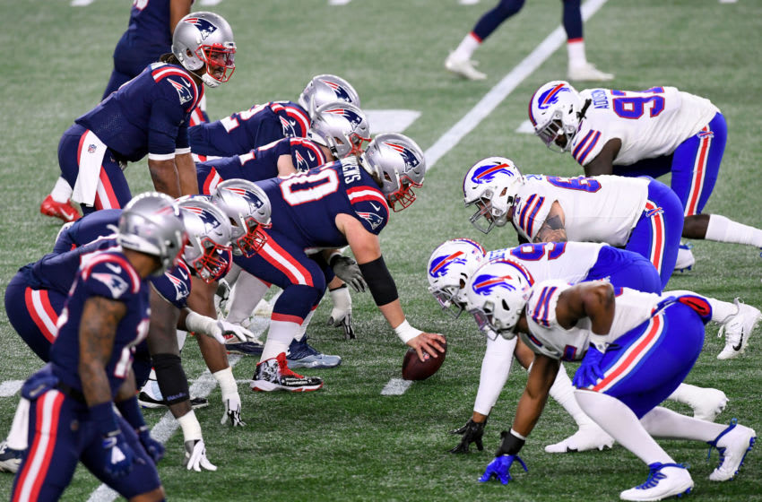 Dec 28, 2020; Foxborough, Massachusetts, USA; New England Patriots center David Andrews (60) prepares to snap the ball to quarterback Cam Newton (1) during the second quarter of a game against the Buffalo Bills at Gillette Stadium. Mandatory Credit: Brian Fluharty-USA TODAY Sports