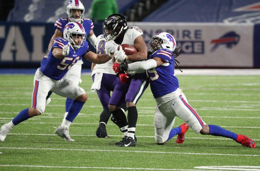 Bills linebackers Tremaine Edmunds and Matt Milano wrap up Ravens running back J.K. Dobbins. Jg 011620 Bills 8