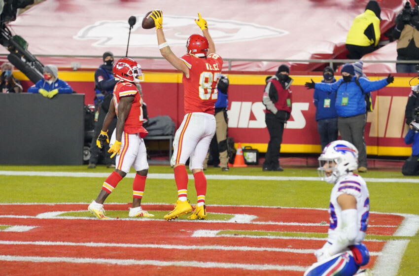 Jan 24, 2021; Kansas City, MO, USA; Kansas City Chiefs tight end Travis Kelce (87) celebrates a touchdown against the Buffalo Bills during the fourth quarter in the AFC Championship Game at Arrowhead Stadium. Mandatory Credit: Denny Medley-USA TODAY Sports