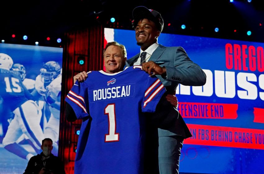 Apr 29, 2021; Cleveland, Ohio, USA; Gregory Rousseau (Miami) with NFL commissioner Roger Goodell after being selected by the Buffalo Bills as the number 30 overall pick in the first round of the 2021 NFL Draft at First Energy Stadium. Mandatory Credit: Kirby Lee-USA TODAY Sports