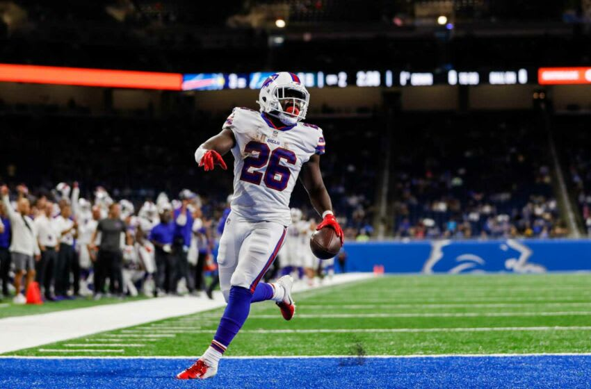 Buffalo Bills running back Devin Singletary (26) scores a touchdown against Detroit Lions during the first half of the preseason game at Ford Field in Detroit on Friday, Aug. 13, 2021.