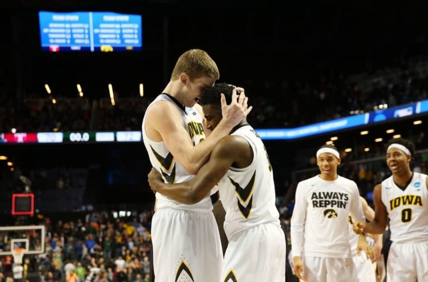 Mar 18, 2016; Brooklyn, NY, USA; Iowa Hawkeyes center Adam Woodbury (left) hugs guard Anthony Clemmons (5) after making the game-winning basket against the Temple Owls in overtime in the first round of the 2016 NCAA Tournament at Barclays Center. Mandatory Credit: Anthony Gruppuso-USA TODAY Sports