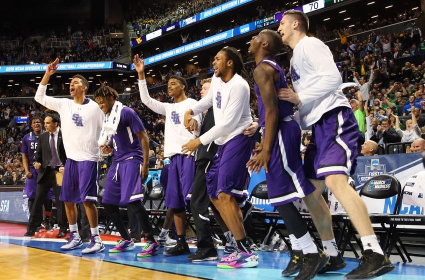 Mar 18, 2016; Brooklyn, NY, USA; Stephen F. Austin Lumberjacks players celebrate on the bench against the West Virginia Mountaineers in the second half in the first round of the 2016 NCAA Tournament at Barclays Center. Mandatory Credit: Anthony Gruppuso-USA TODAY Sports