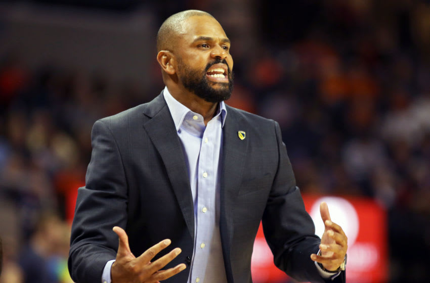 CHARLOTTESVILLE, VA - NOVEMBER 16: Head coach Juan Dixon of the Coppin State Eagles argues a call in the first half during a game against the Virginia Cavaliers at John Paul Jones Arena on November 16, 2018 in Charlottesville, Virginia. (Photo by Ryan M. Kelly/Getty Images)