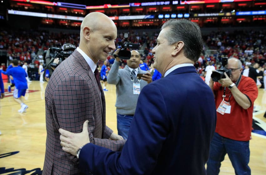 LOUISVILLE, KY - DECEMBER 29: Chris Mack the head coach of the the Louisville Cardinals and John Calipari the head coach of the Kentucky Wildcats talk before the game at KFC YUM! Center on December 29, 2018 in Louisville, Kentucky. (Photo by Andy Lyons/Getty Images)