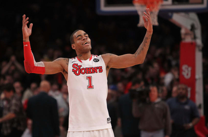 NEW YORK, NY - JANUARY 30: D.J. Kennedy #1 of the St. John's Red Storm celebrates the win against the Duke Blue Devils at Madison Square Garden on January 30, 2011 in New York City. (Photo by Nick Laham/Getty Images)