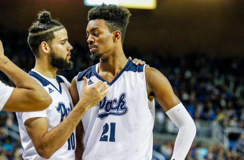 RENO, NEVADA - JANUARY 02: Caleb Martin #10 of the Nevada Wolf Pack talks to teammate Jordan Brown #21 of the Nevada Wolf Pack near the end of the game between the Nevada Wolf Pack and the Utah State Aggies at Lawlor Events Center on January 02, 2019 in Reno, Nevada. (Photo by Jonathan Devich/Getty Images)