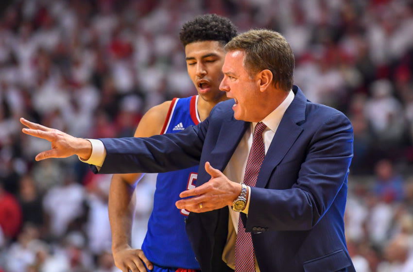 LUBBOCK, TX - FEBRUARY 23: Head coach Bill Self talks with Quentin Grimes #5 of the Kansas Jayhawks during the second half of the game against the Texas Tech Red Raiders on February 23, 2019 at United Supermarkets Arena in Lubbock, Texas. Texas Tech defeated Kansas 91-62. (Photo by John Weast/Getty Images)