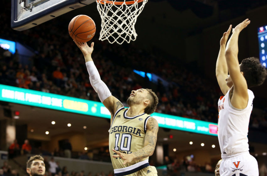 CHARLOTTESVILLE, VA - FEBRUARY 27: Jose Alvarado #10 of the Georgia Tech Yellow Jackets shoots past Kihei Clark #0 of the Virginia Cavaliers in the first half during a game at John Paul Jones Arena on February 27, 2019 in Charlottesville, Virginia. (Photo by Ryan M. Kelly/Getty Images)