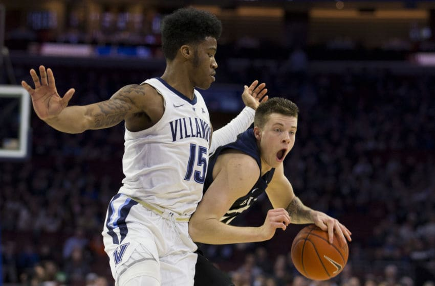 PHILADELPHIA, PA - MARCH 02: Sean McDermott #22 of the Butler Bulldogs dribbles the ball against Saddiq Bey #15 of the Villanova Wildcats in the first half at the Wells Fargo Center on March 2, 2019 in Philadelphia, Pennsylvania. (Photo by Mitchell Leff/Getty Images)